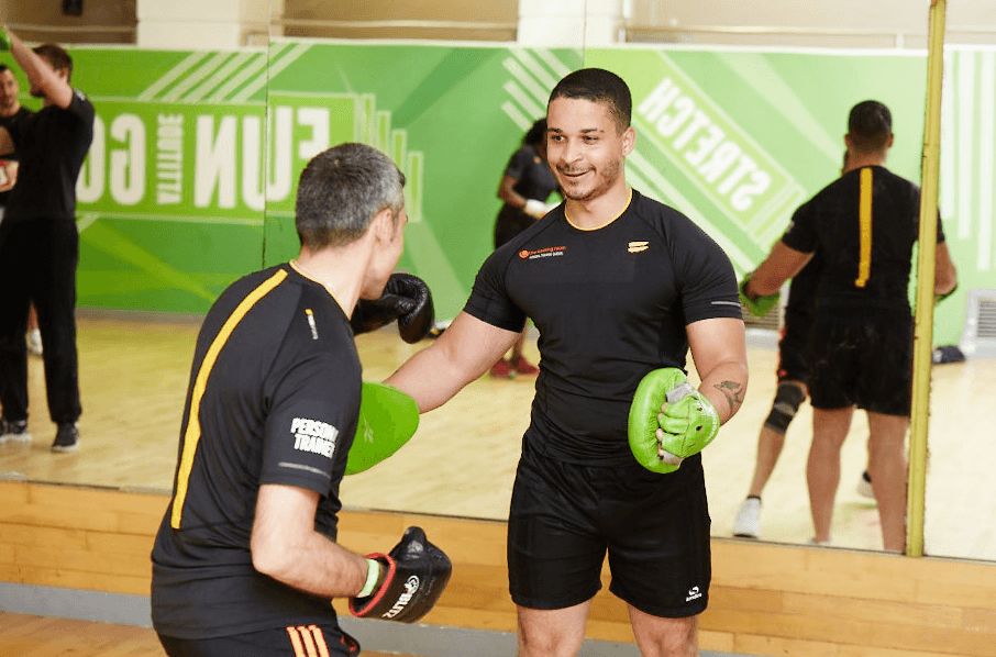 students boxing in a gym