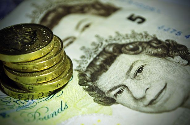 Pound coins and five pound note
