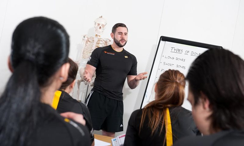 Tutor teaching personal training students