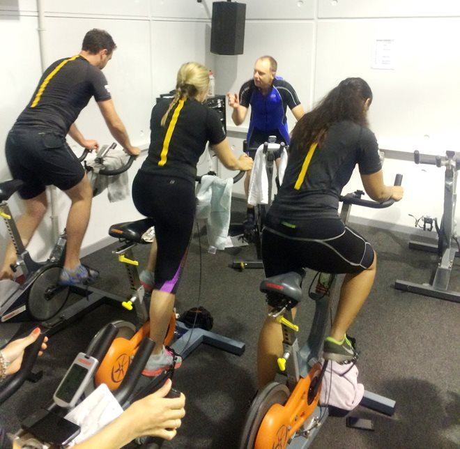 Group doing a spin class in the gym