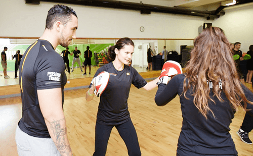 Personal Trainer Coaching girls in boxing